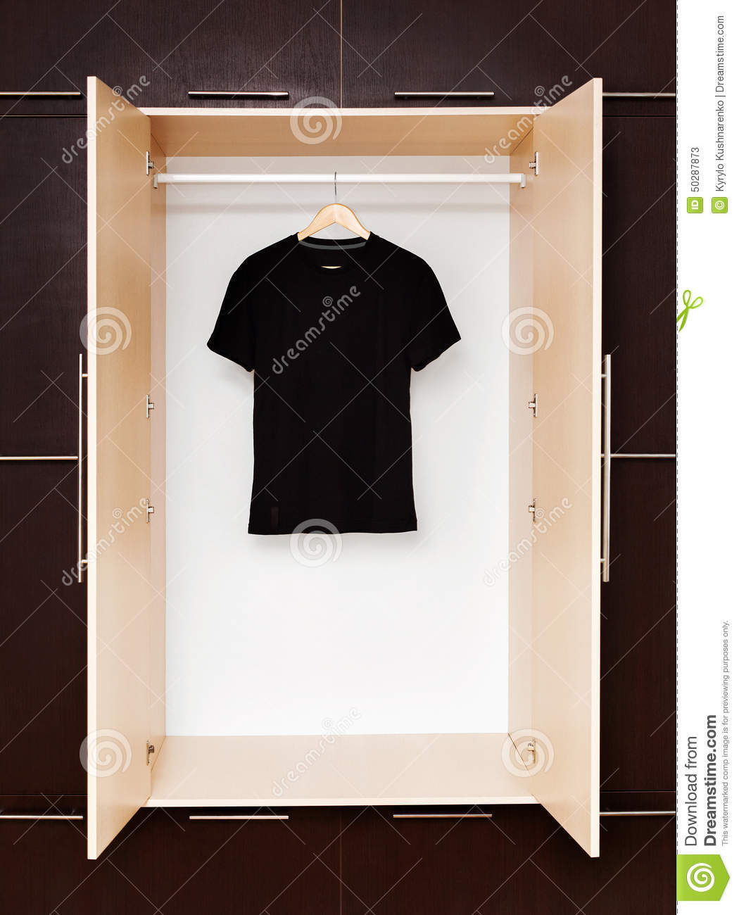 Black T Shirt On Wooden Hangers In A Closet Stock Photo