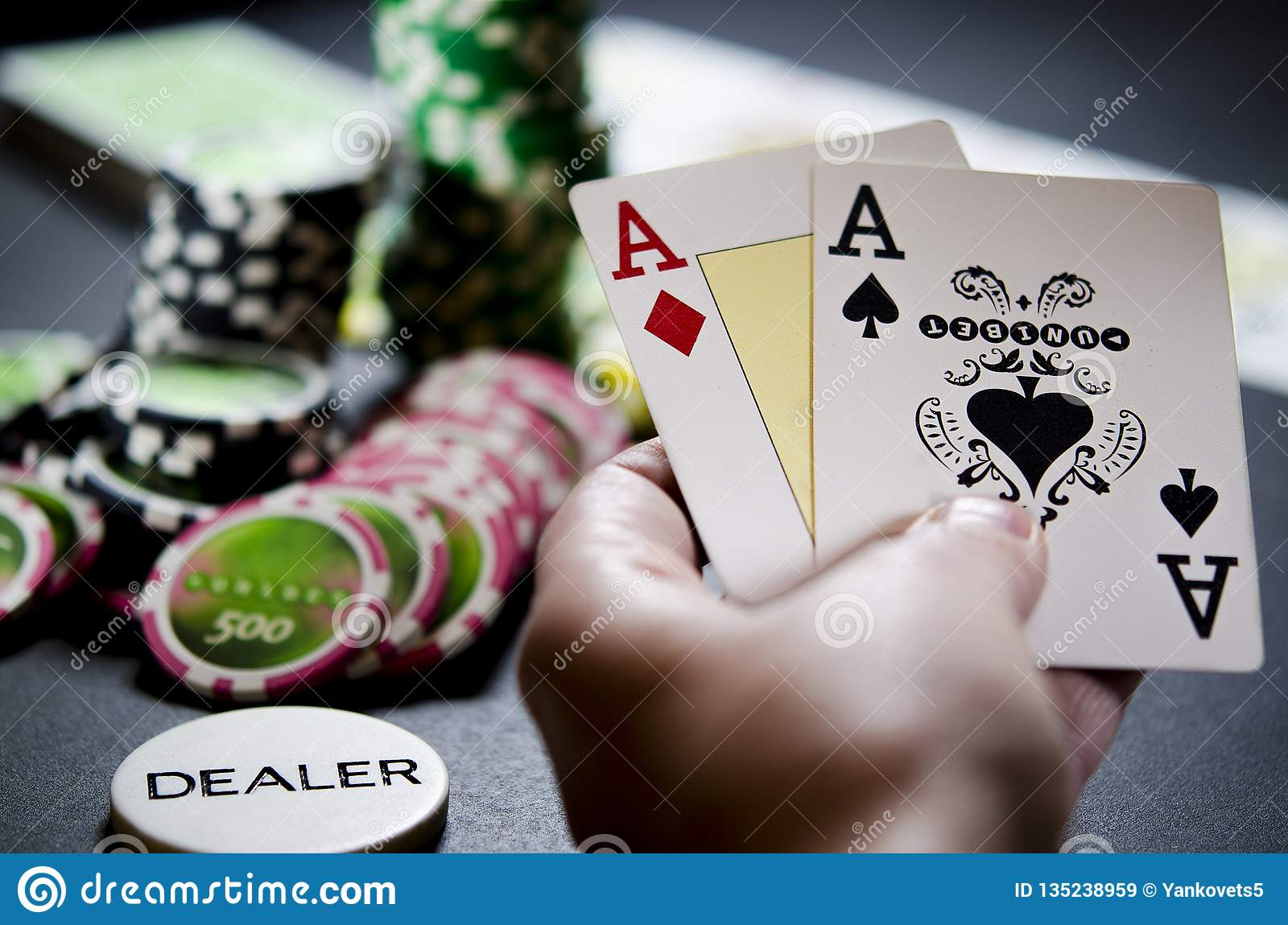 Person looking at their cards in poker free slots games to play