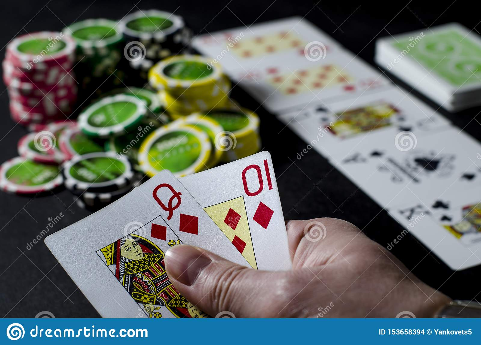 Person looking at their cards in poker Tesco slots free to play