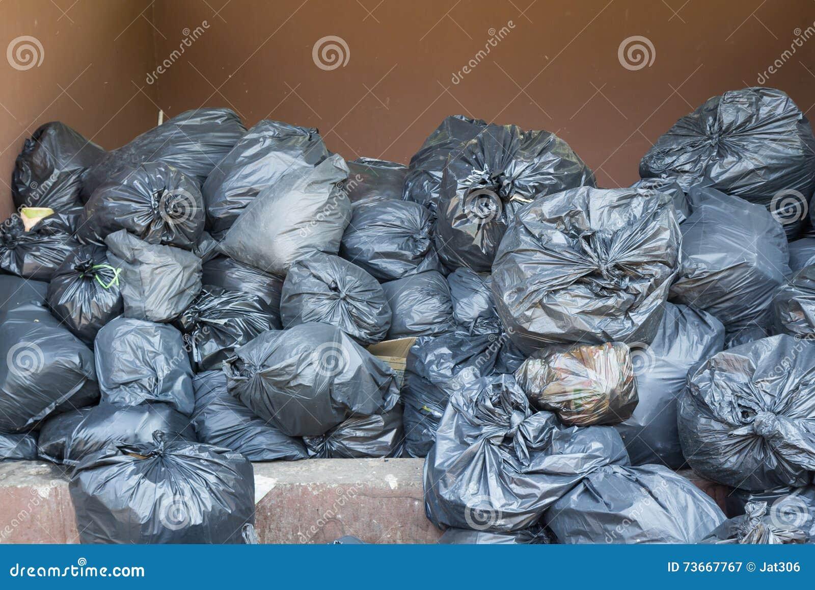 Black Trash Bags Pile Stock Photo - Image: 73667767