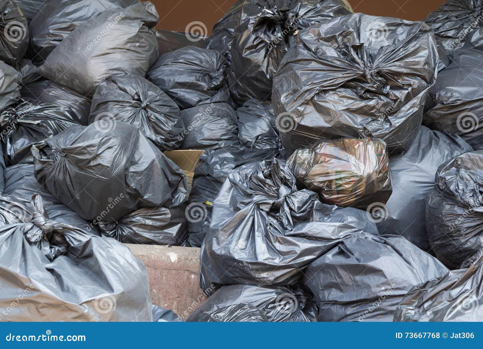 Black Trash Bags Pile Stock Photo - Image: 73667768