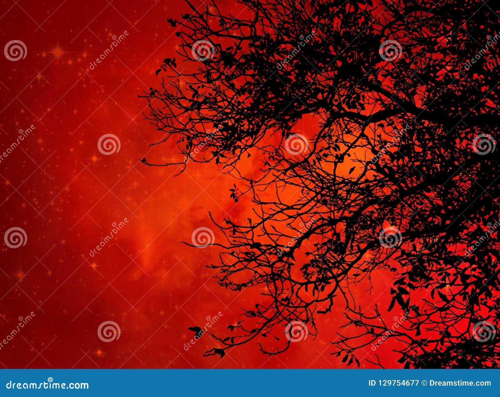 Black tree against orange galaxy