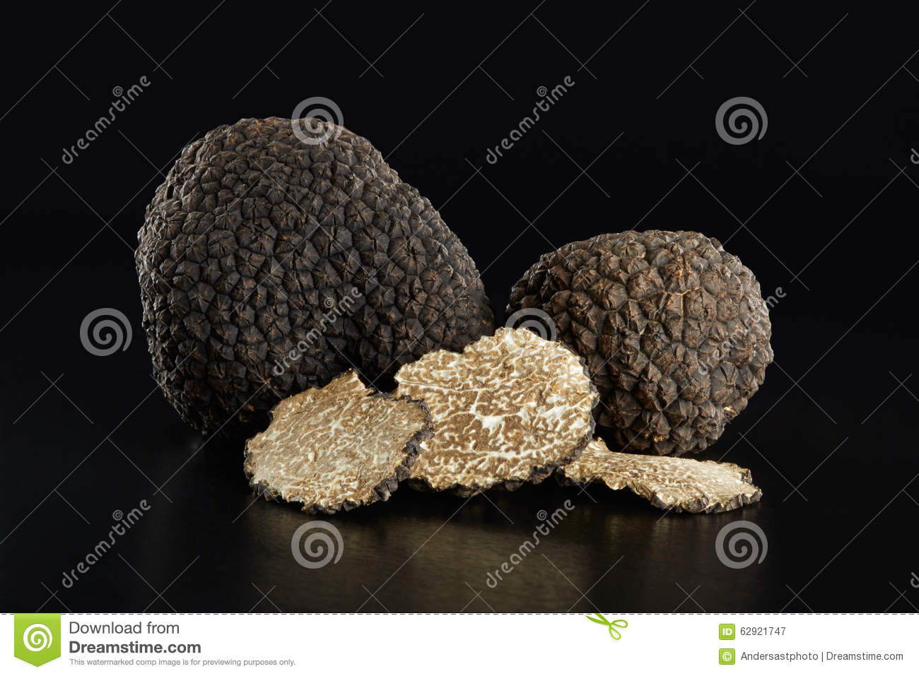 Black truffles and slices on black