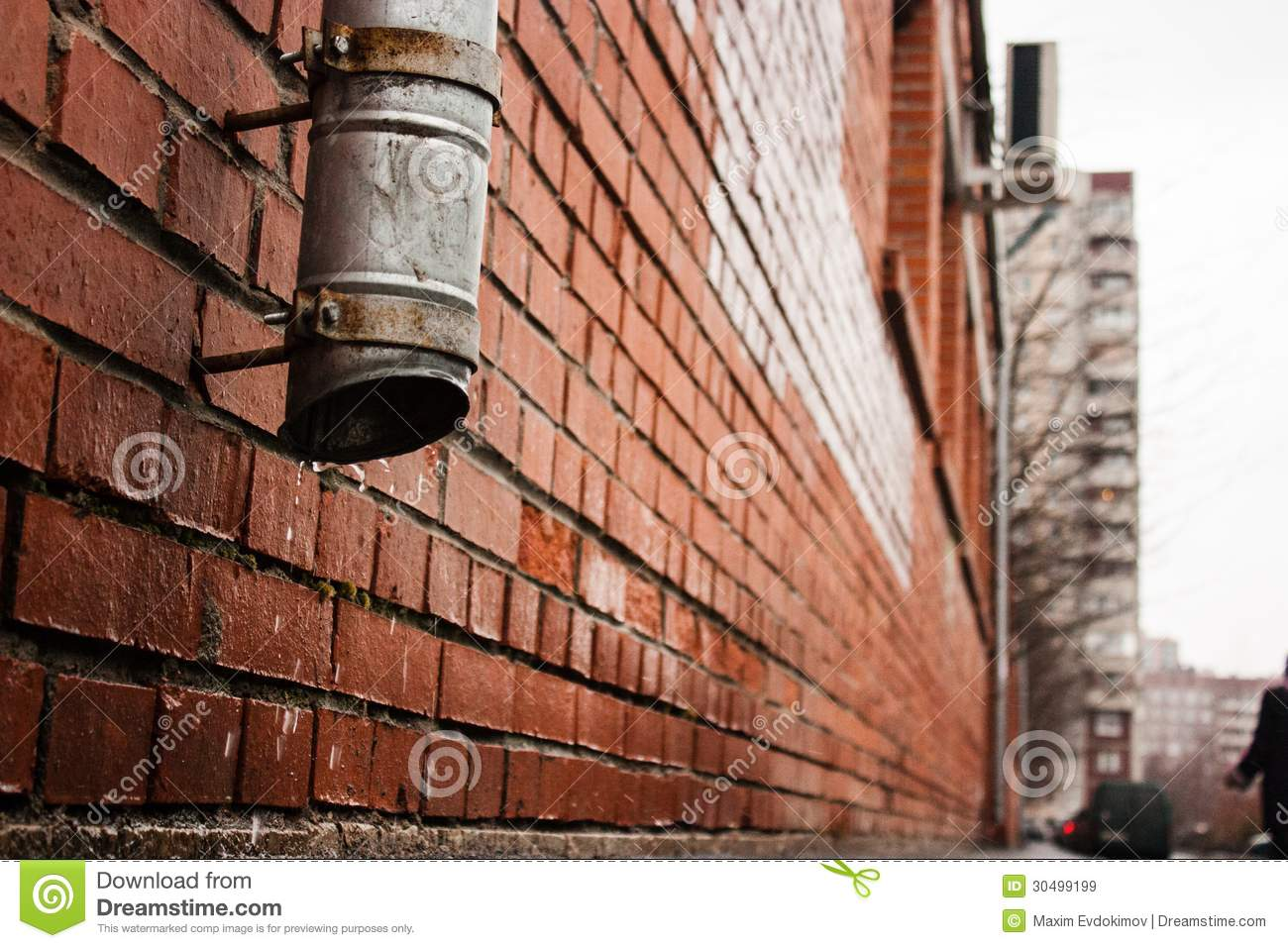 Black tube on a brick house wall drain water stock image for Water wall plumbing