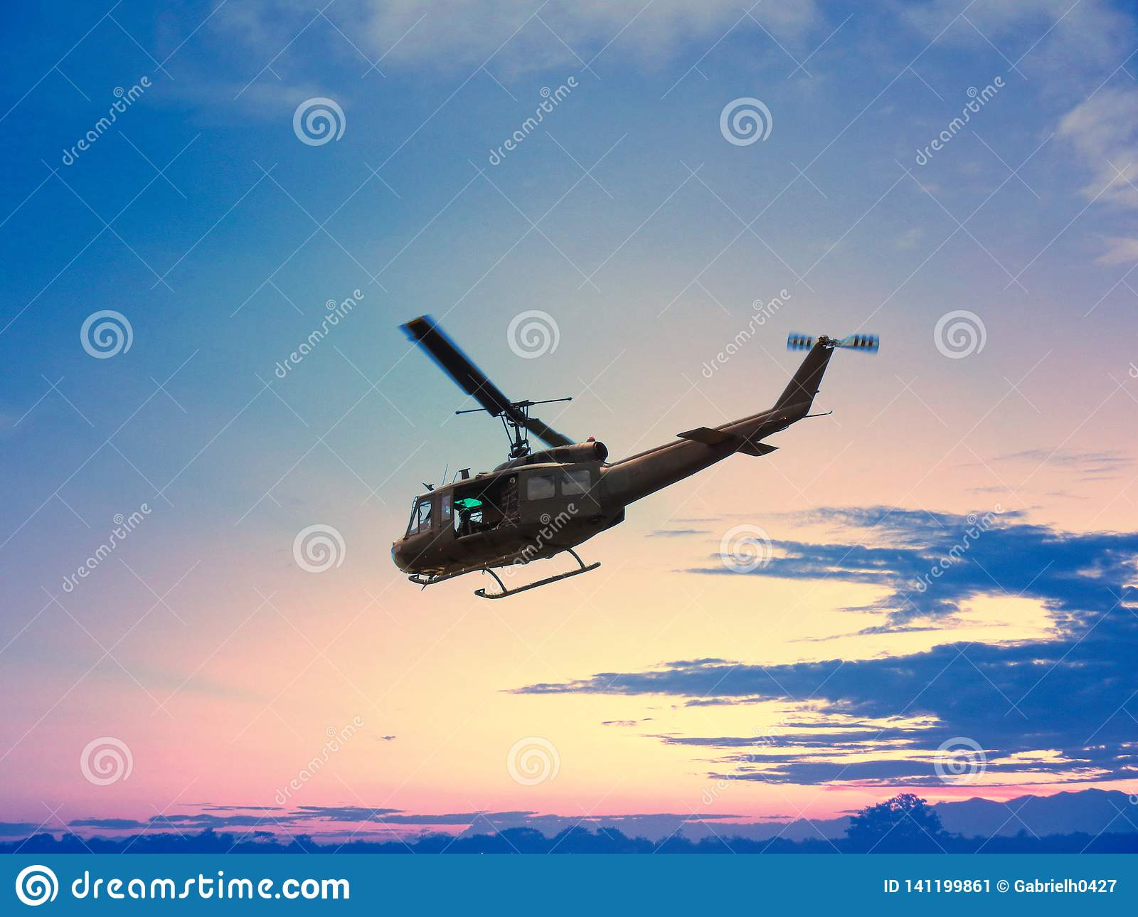 Black Helicopter Flying In Nice Sunset With Red And Yellow