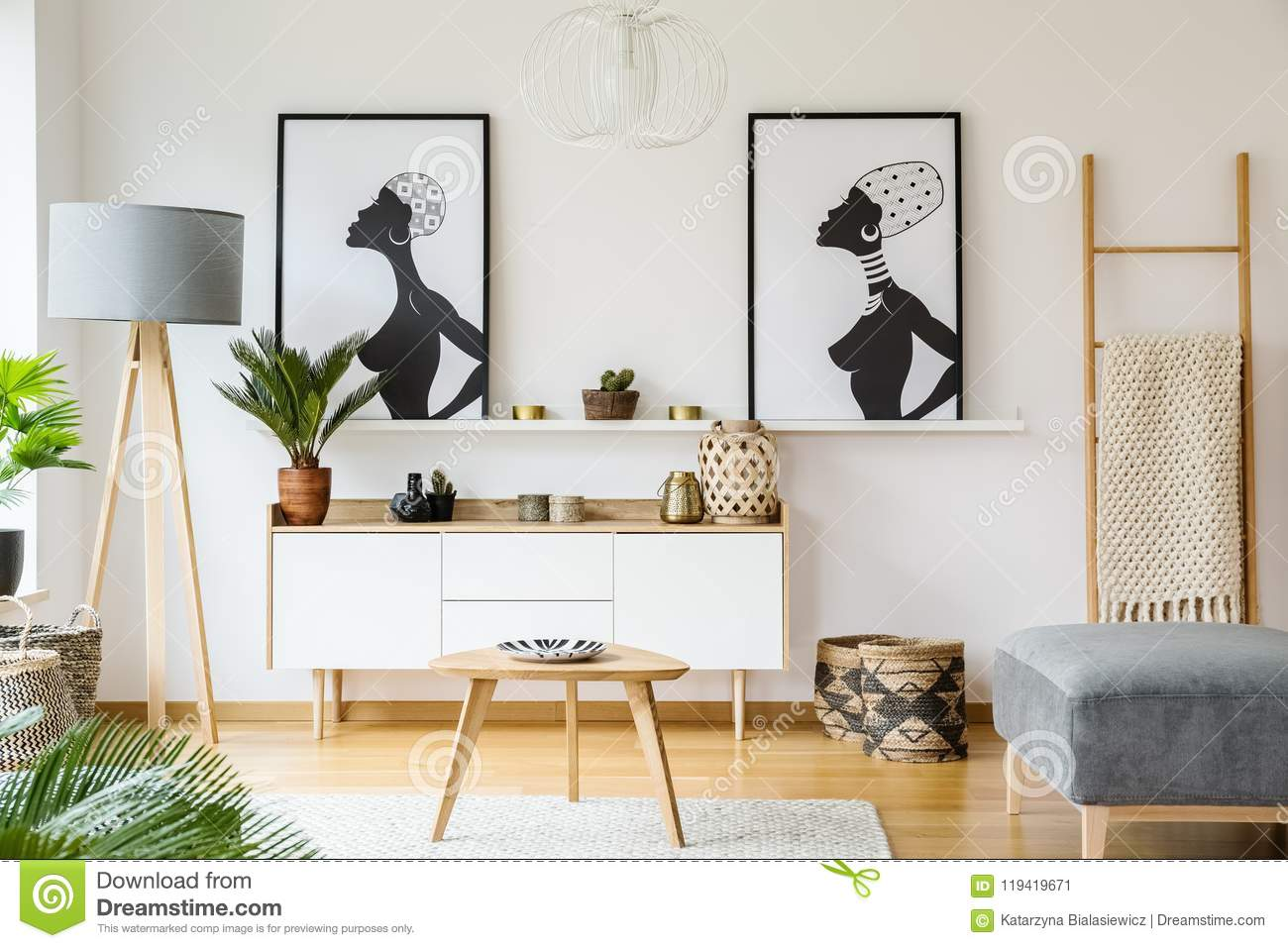 Black And White African Posters Above Cabinet In Living Room Int ...