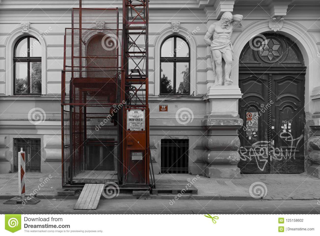 Black And White Ancient Wall With Modern Red Elevator Under