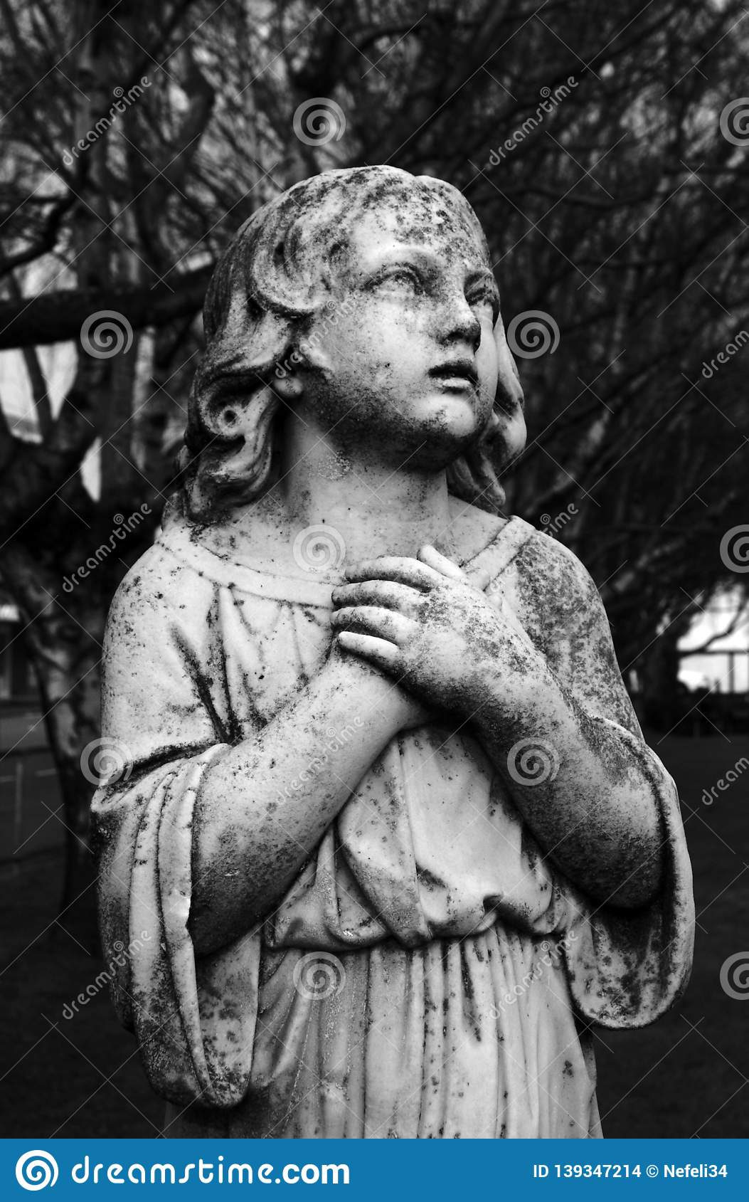Black and White Angel Sculpture in Churchyard Cemetery