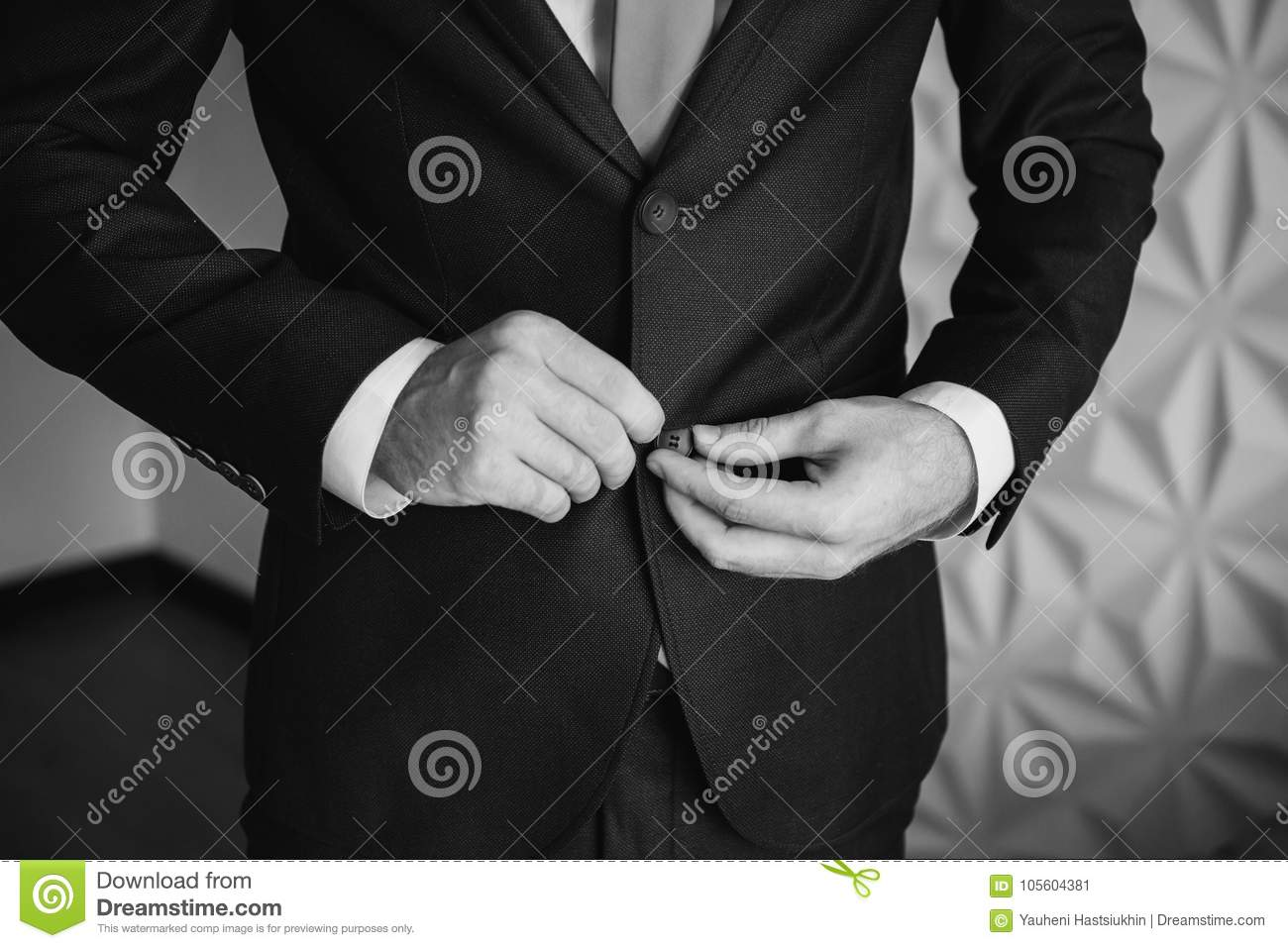 Black and white art photography monochrome man buttoning his waistcoat on mens style professions preparing to work on an appointment