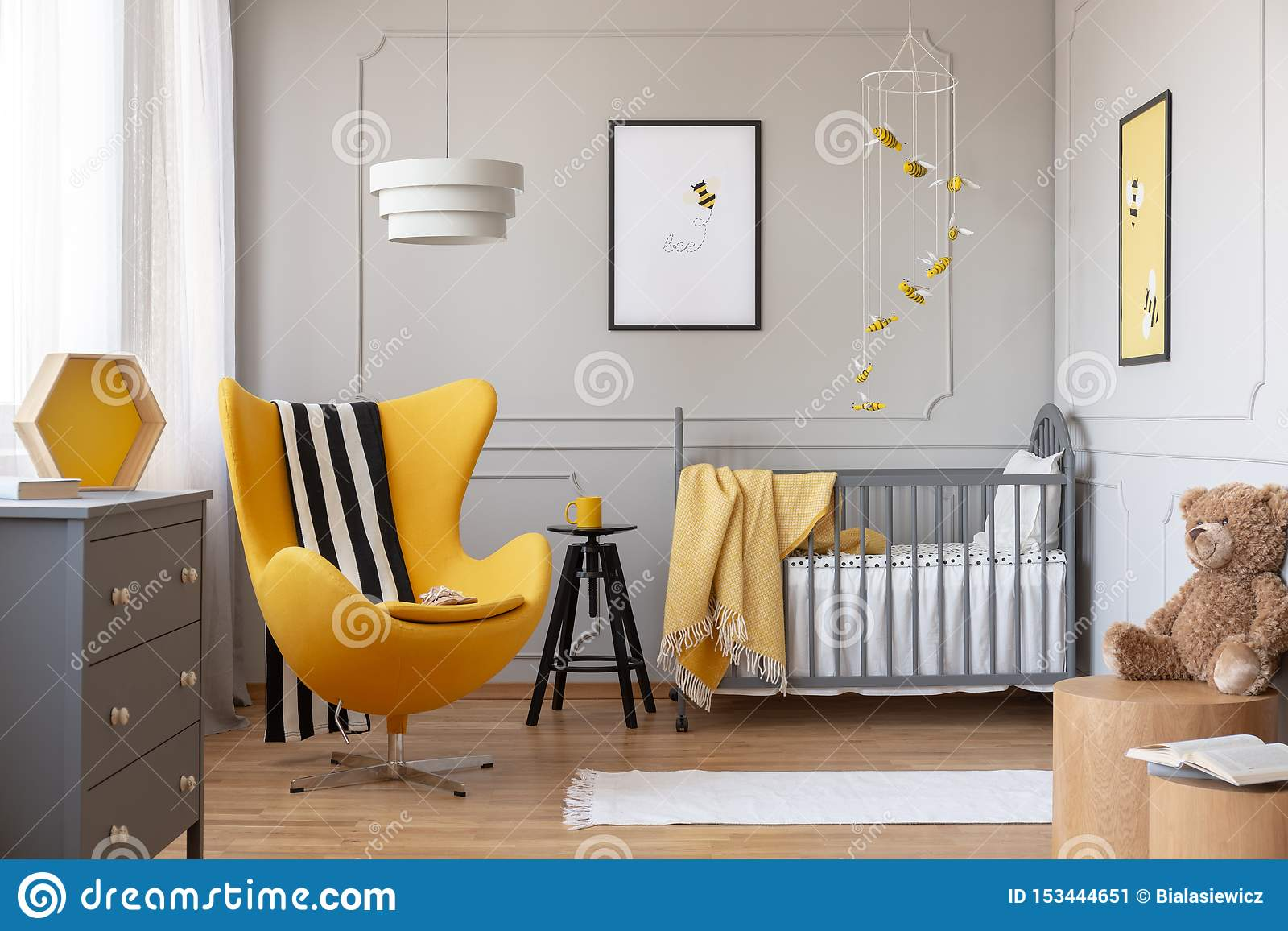Black And White Blanket On Yellow Egg Chair In Grey Baby ...