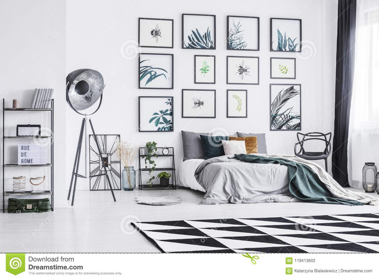 Black And White Carpet Placed On The Floor In Bright Bedroom Interior With King Size Bed Black Studio Lamp And Posters Hanging On Stock Photo Image Of Bedding Hanging 119413602