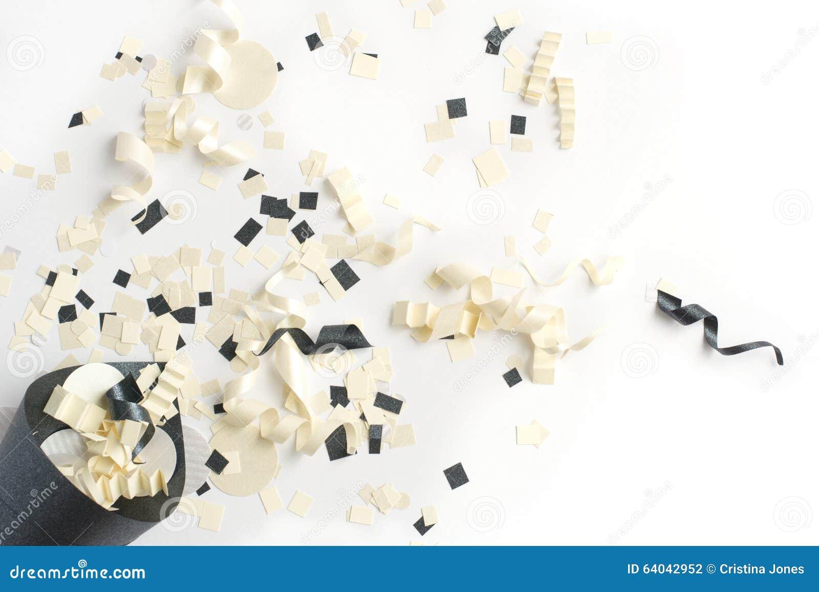 black white champagne and silver confetti popper stock photo