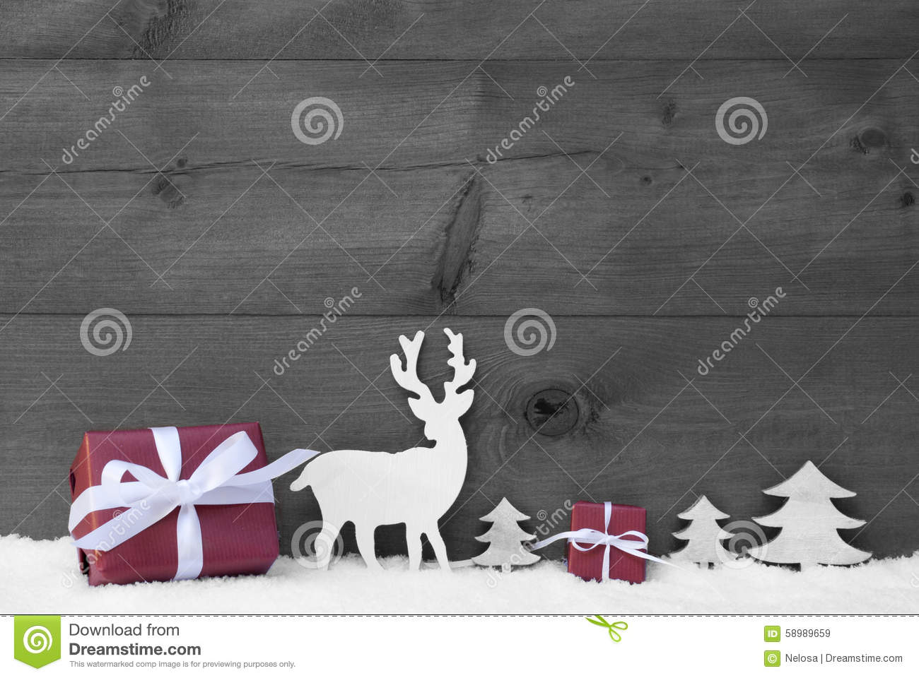 Black and white christmas decoration with red gifts or presents moose or reindeer and christmas trees on snow christmas card for seasons greetings