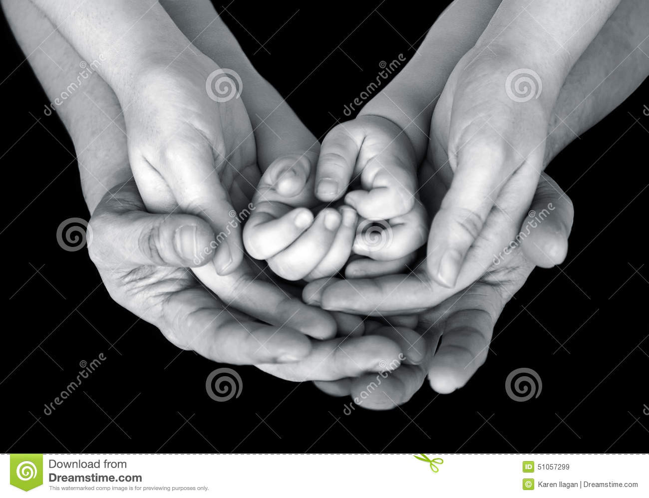 black and white close up image of a family s supporting hands stock