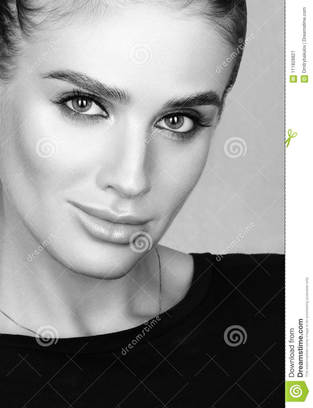 Black and white closeup beauty portrait of beautiful young woman with professional colourful make up