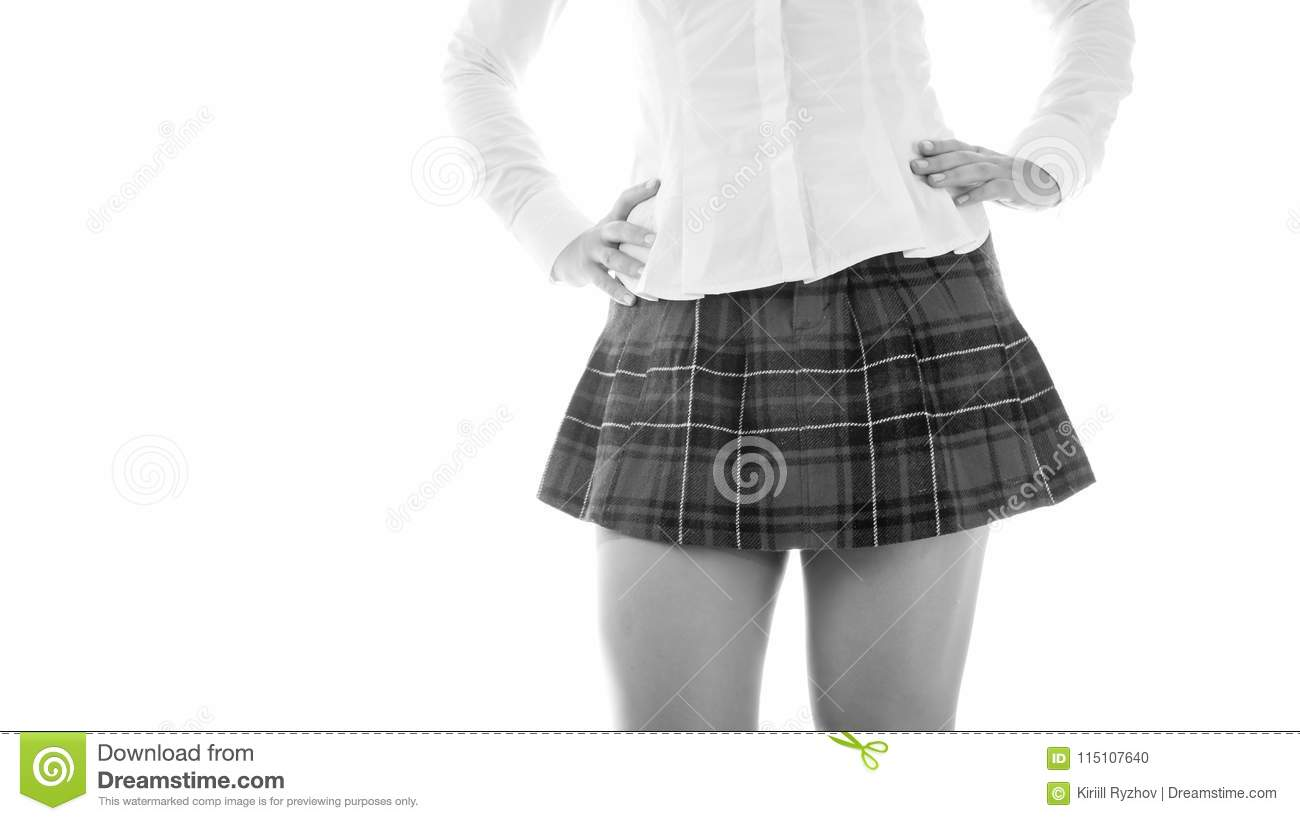6a5132be4a Royalty-Free Stock Photo. Black and white closeup photo of student girl in  short skirt