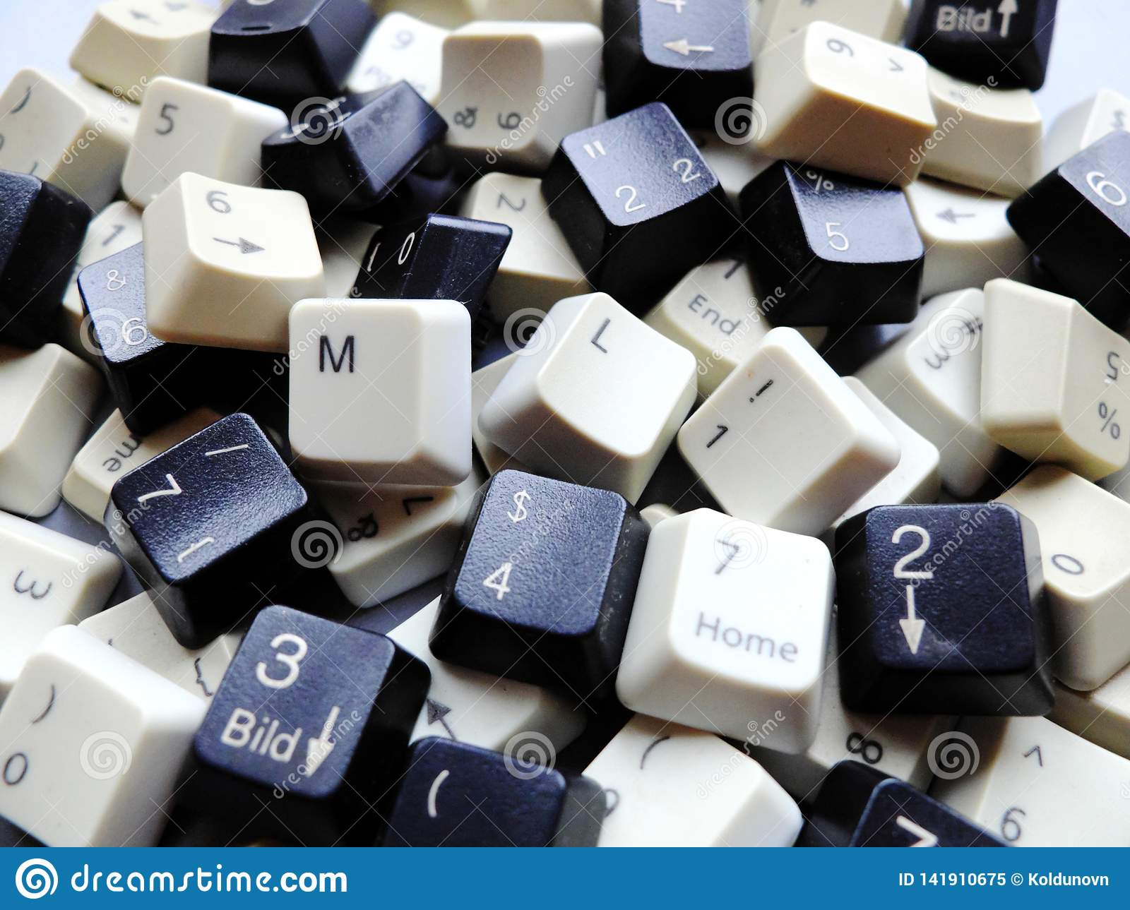 Black and white computer keyboard keys, mostly numeric with ML Machine learning buttons at the front. Concept of unstructured