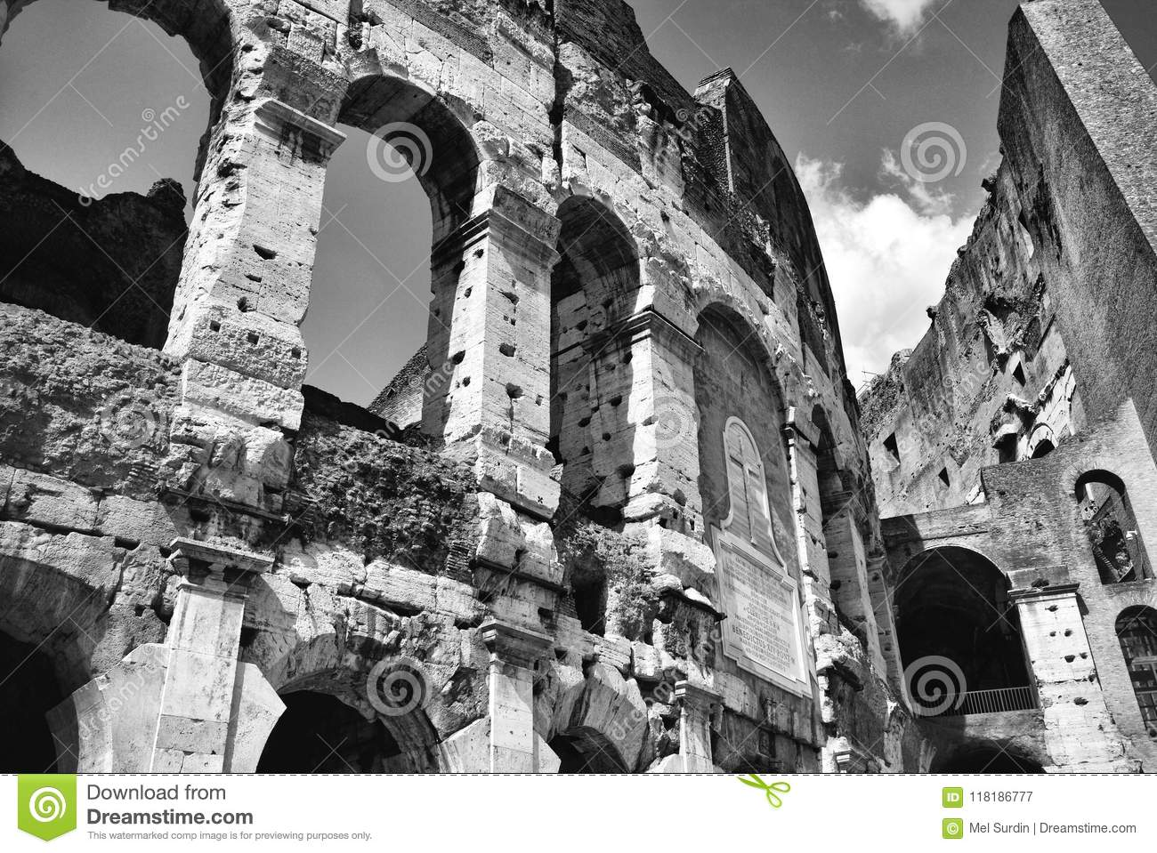 Black and white detail of the walls of the coliseum in rome italy