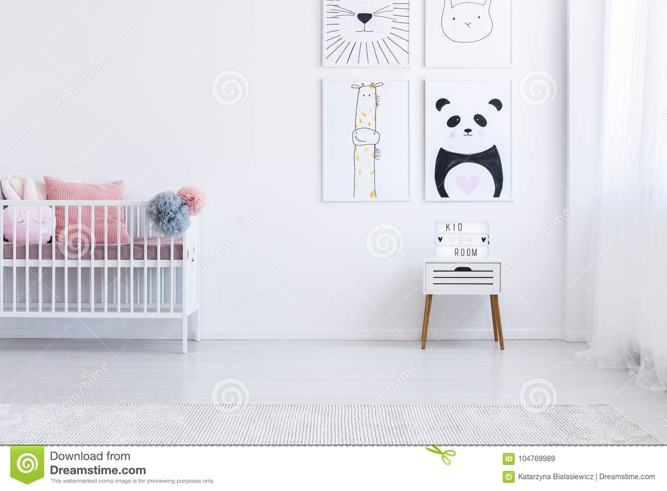 Black and white drawing on wall above cabinet in kids interior with pastel bedding