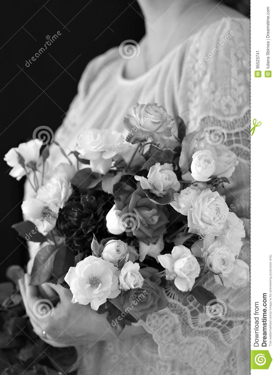 Black and white flower bouquet in an womans hands stock image black and white flower bouquet in an womans hands izmirmasajfo