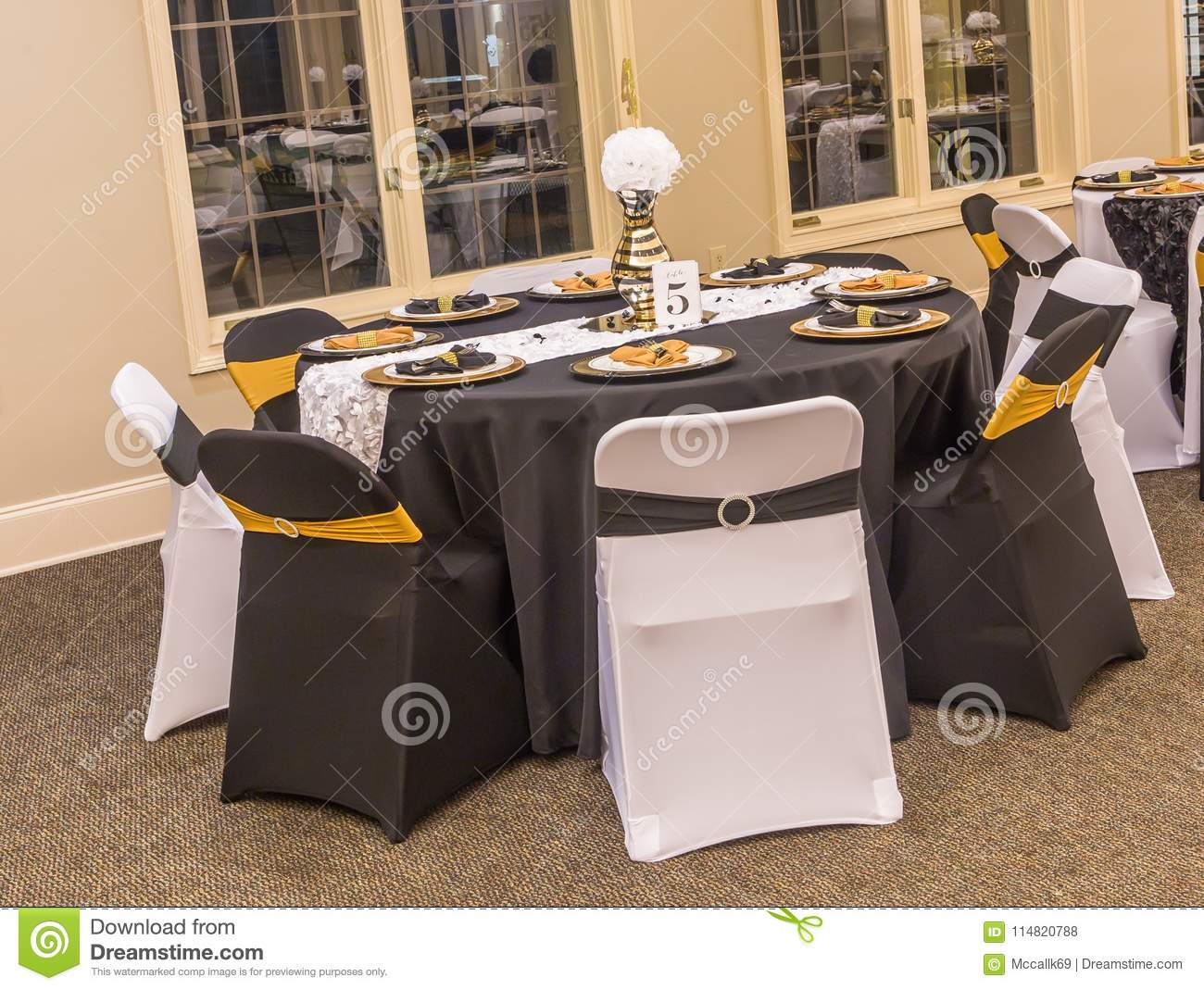 Gold Center Piece And Event Decor Or Presentation At A Birthday Party With Black White As Theme Colors