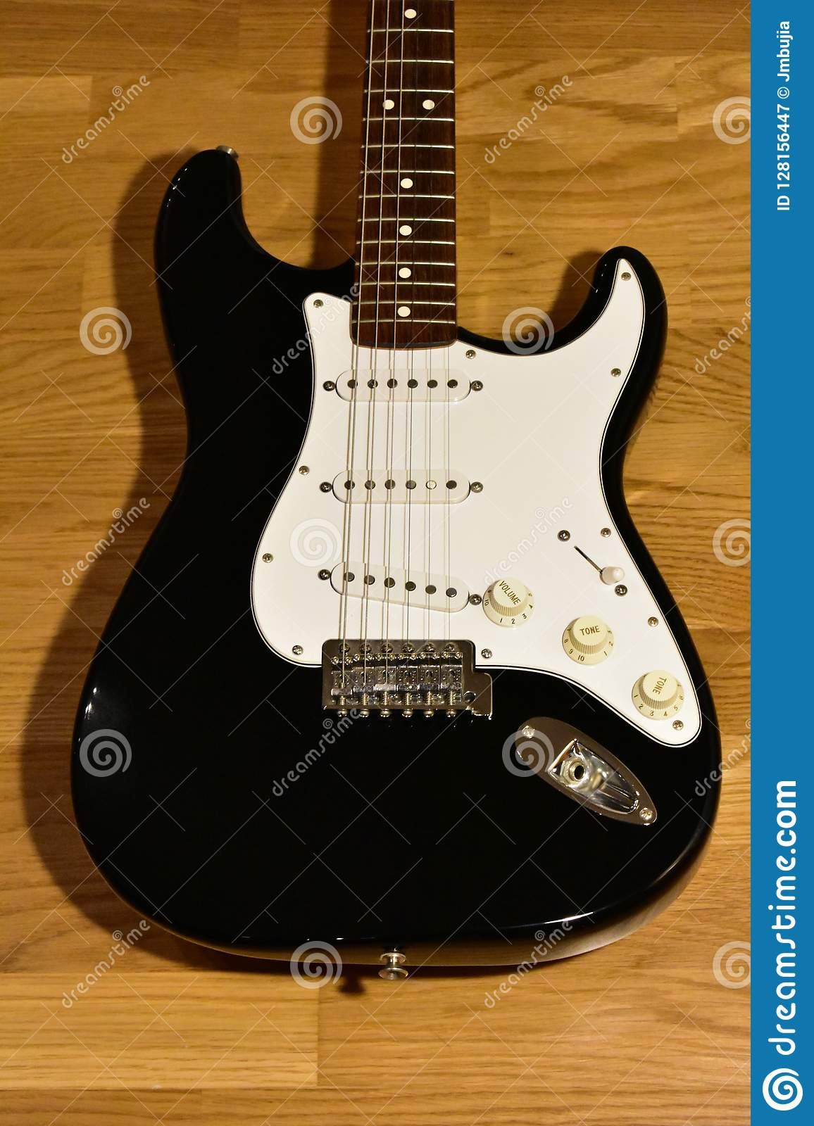 Black And White Guitar On Wood Floor  Body Detail  Stock
