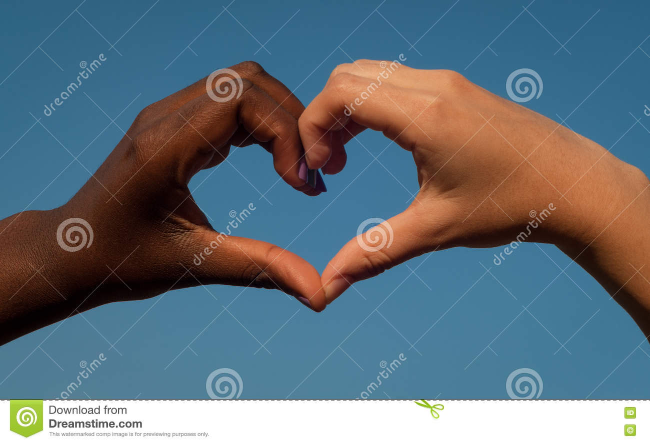 Black and white hands in heart shape interracial friendship