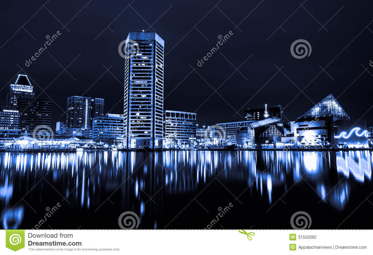 Black and white image of the Baltimore Inner Harbor Skyline at night.