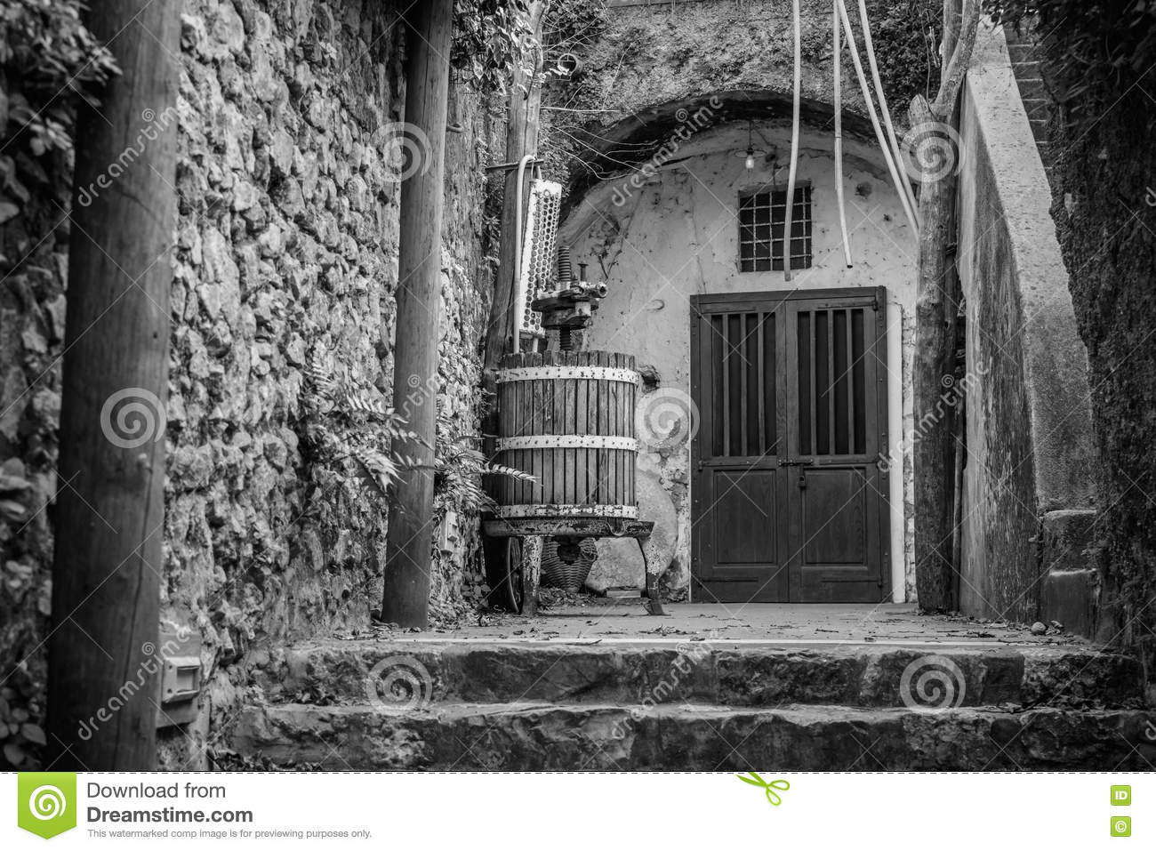 Black And White Image With Wine Press And Closed Doors. Old Ital Stock Photo & Ital Doors \u0026 Denver Door Store Pezcame.Com