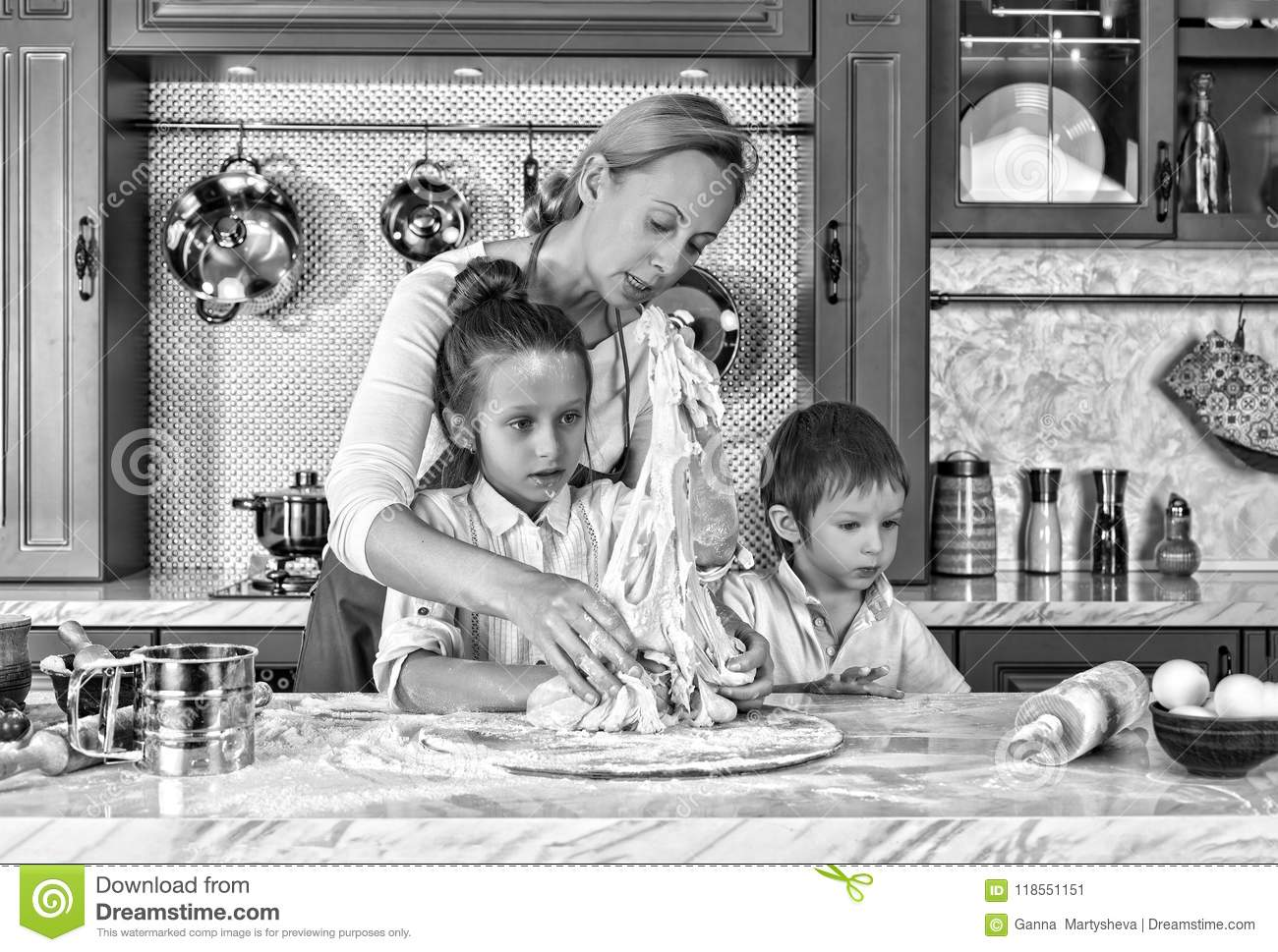 Black and white. mother`s day. mother, cooking, dough, preparation, baking, children at home, kitchen. having fun