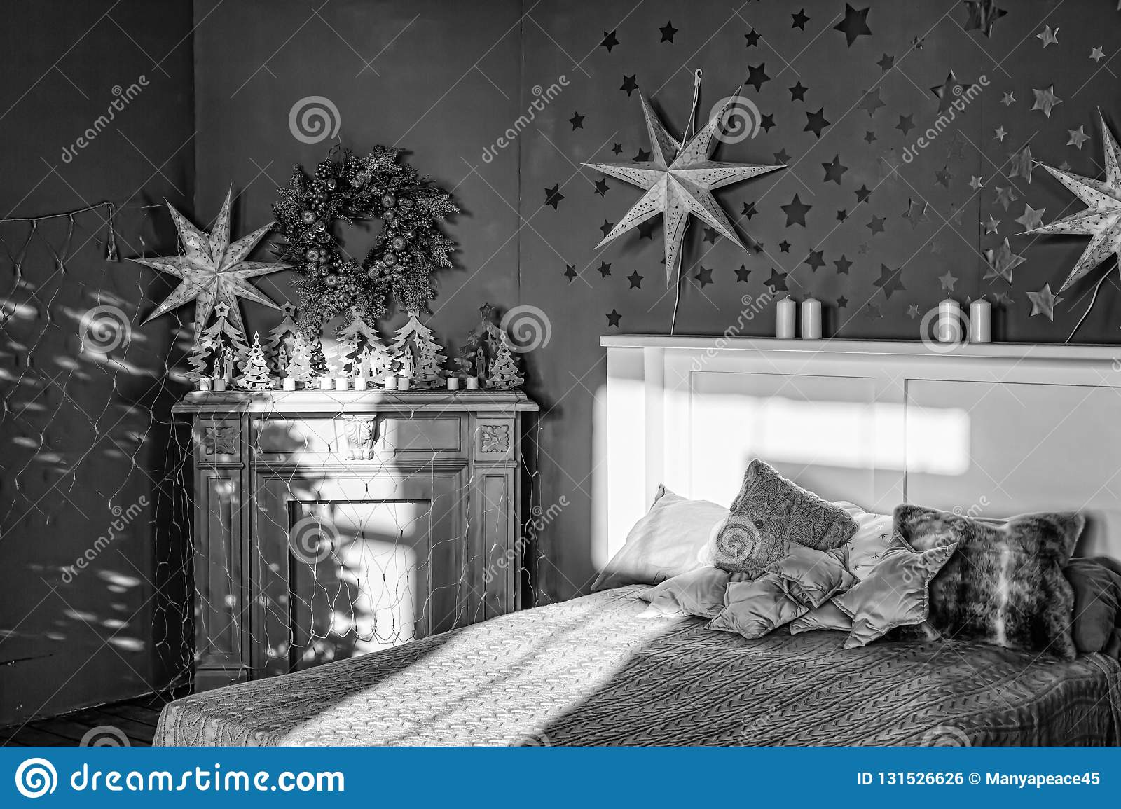 Black and white new years interior bedroom with fireplace decorated with christmas