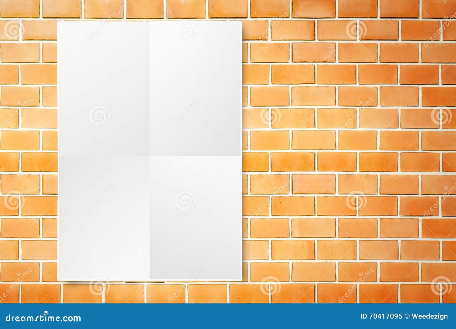 Black white paper poster hanging at grunge orange brick wall.