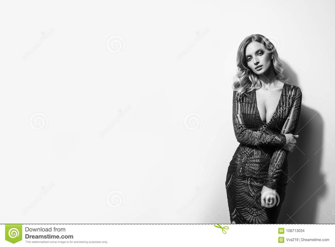Black And White Photo Of Gorgeous Woman On Light Background