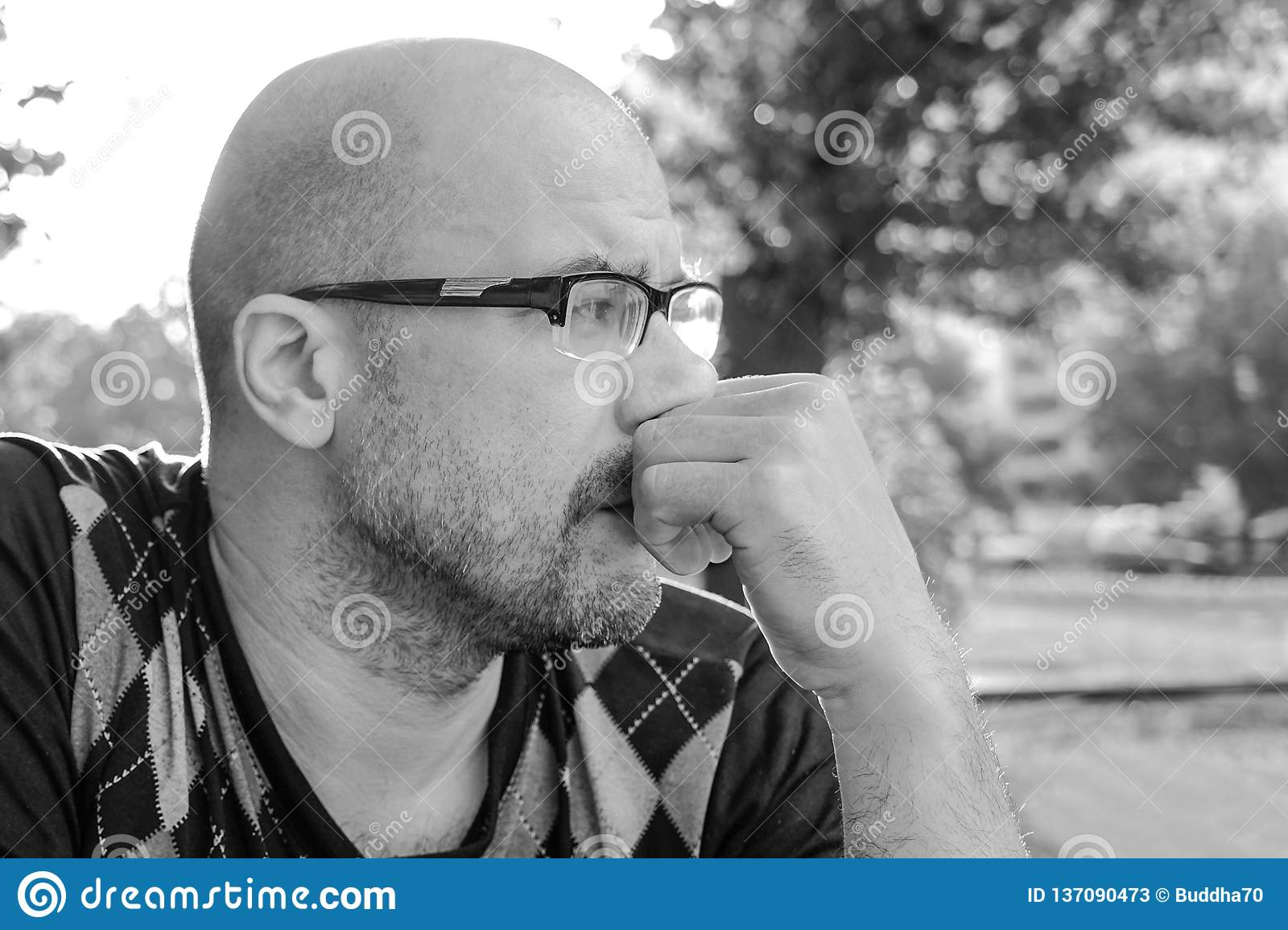 Black and white photo the man with glasses is depressed problems in personal life