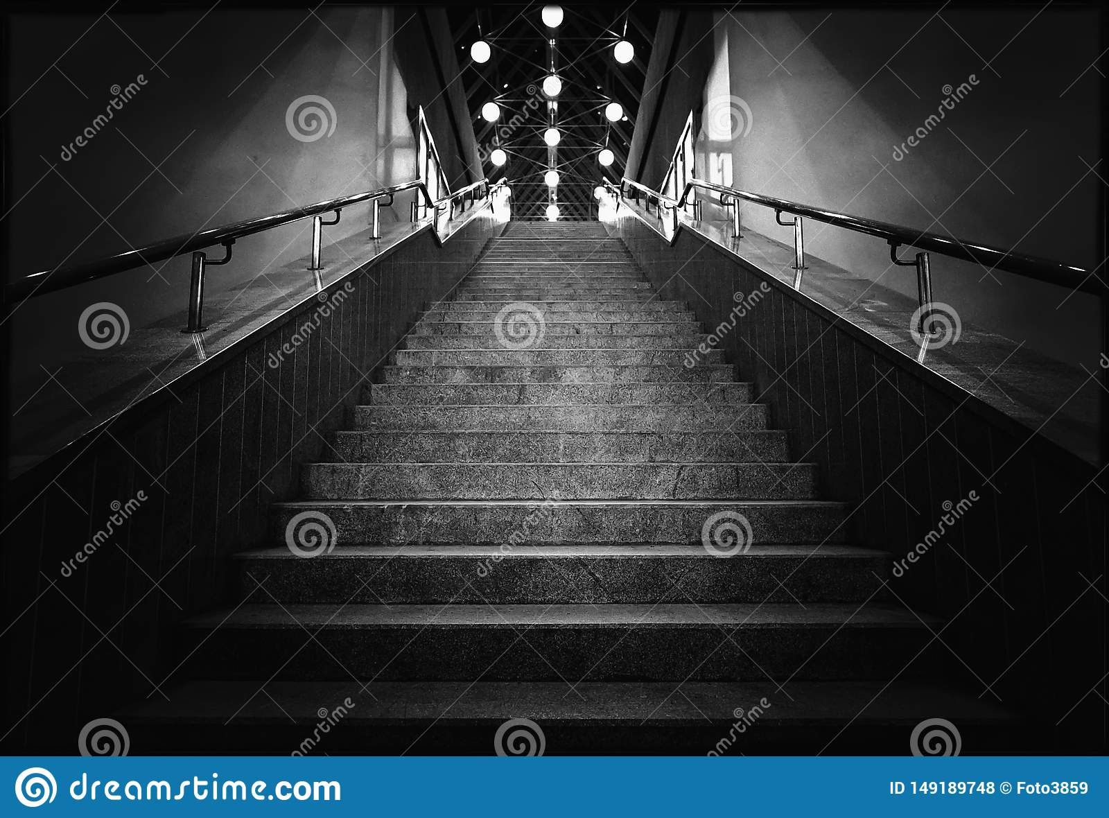 Black and white photo of night stairs with lanterns
