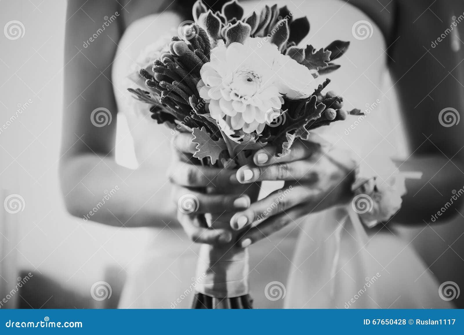 Black white photography beautiful wedding bouquet of flowers in black white photography beautiful wedding bouquet of flowers in hands the bride stock photo image of dress bracelet 67650428 mightylinksfo