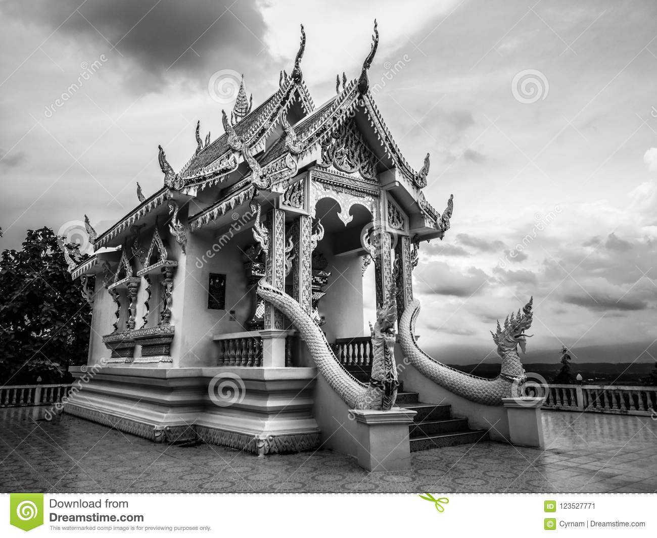 Black and white photography with little buddhist white temple with nobody and dramatic cloudy sky in