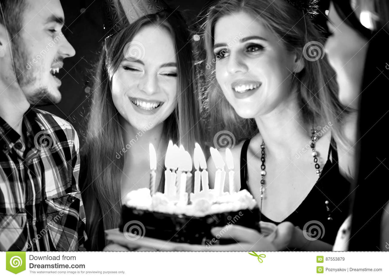 Black white pictures of happy friends birthday party candle cakes