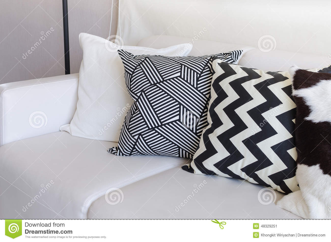 Black and white pillows on sofa in living room at home - Cojines decorativos para sofas ...
