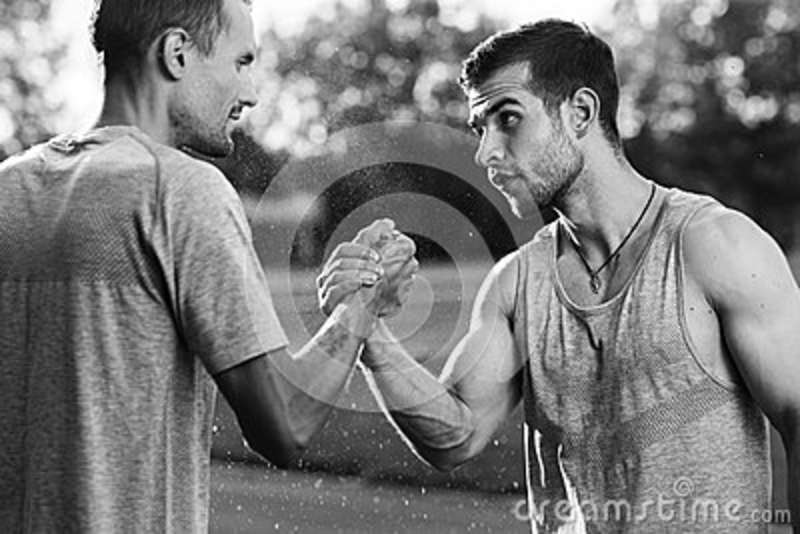 Black and white portrait of handsome men with arm wrestling