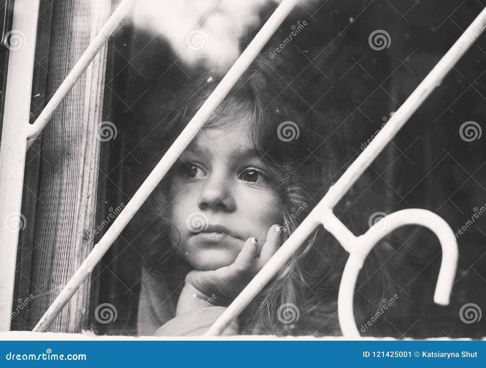 Black And White Portrait Of Sad Little Girl Looks Through Window Stock Image Image Of Glance Hopeful 121425001