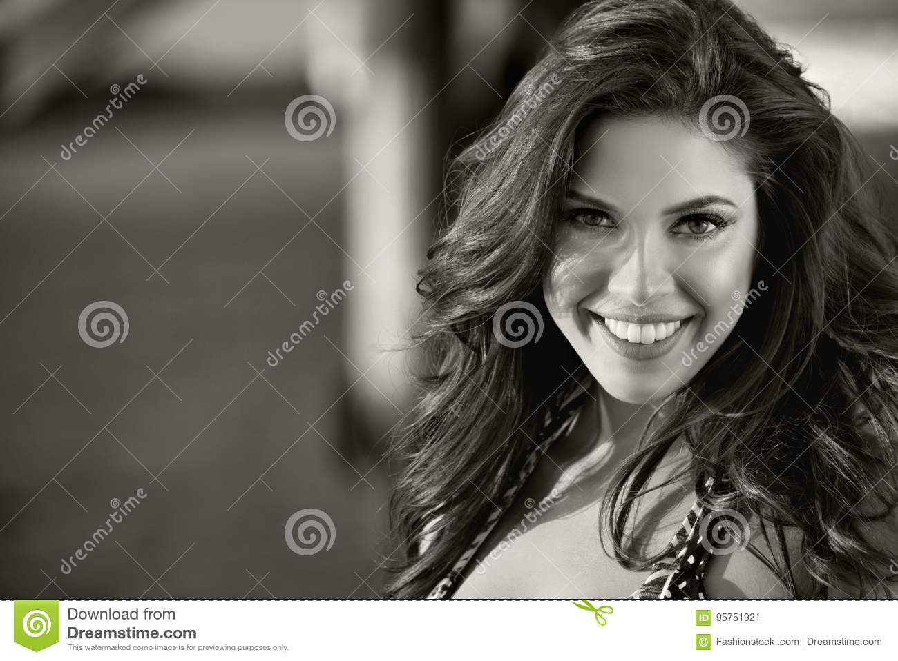 Black and white portrait of gorgeous smiling girl looking at camera