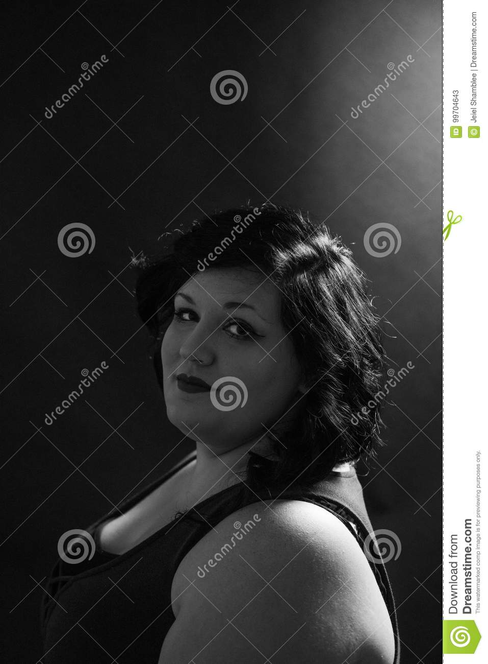 Black White Portrait Of Smiling Young Woman With Dark Highlights