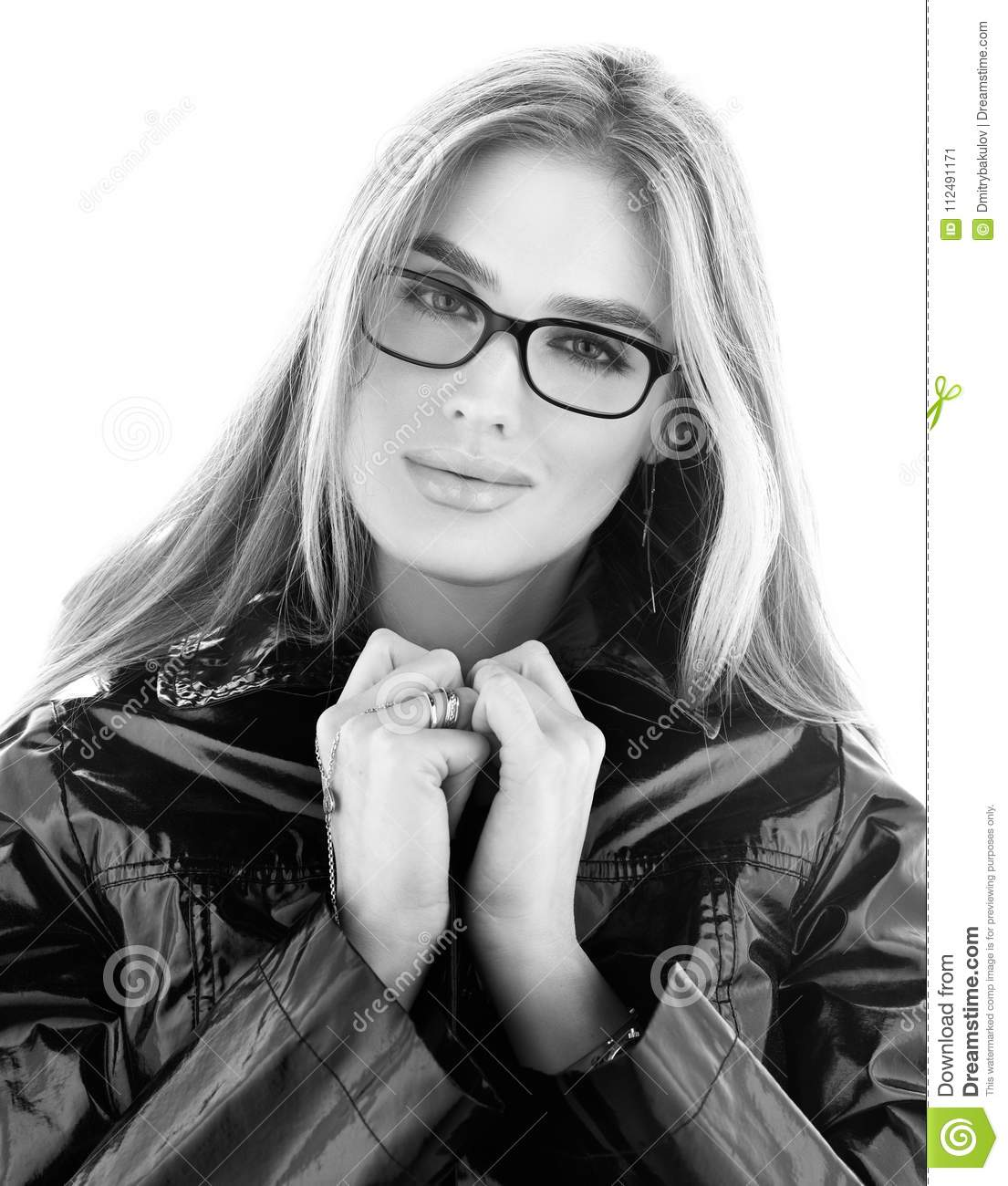 f04634320 Black and white portrait of stylish young woman in glasses. Hair down.  Bright white background