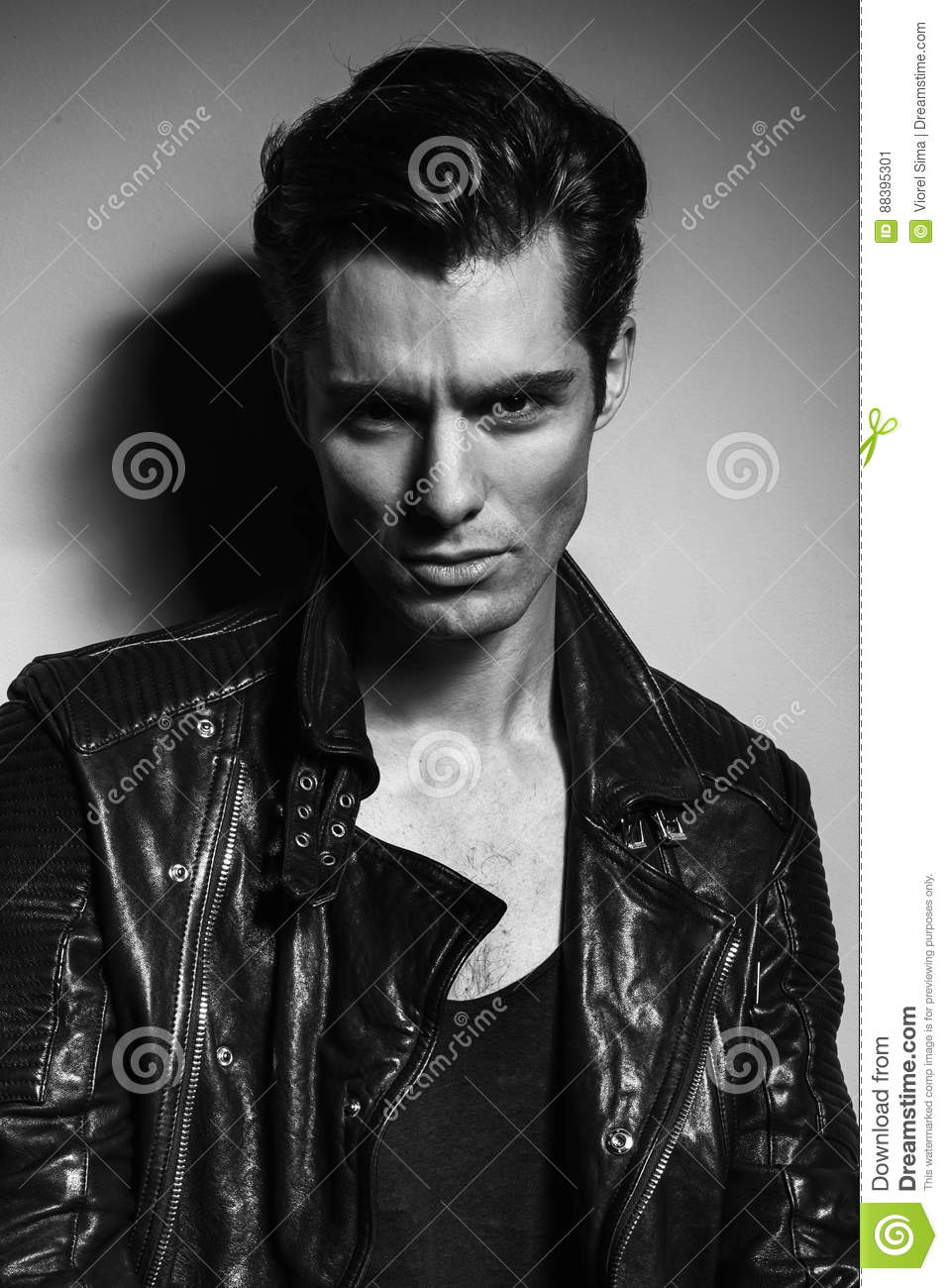 serious young man  leather jacket  black and white stock image