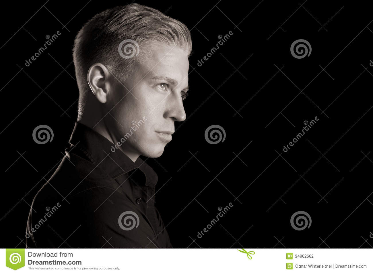 Black and white profile portrait of attractive man low key