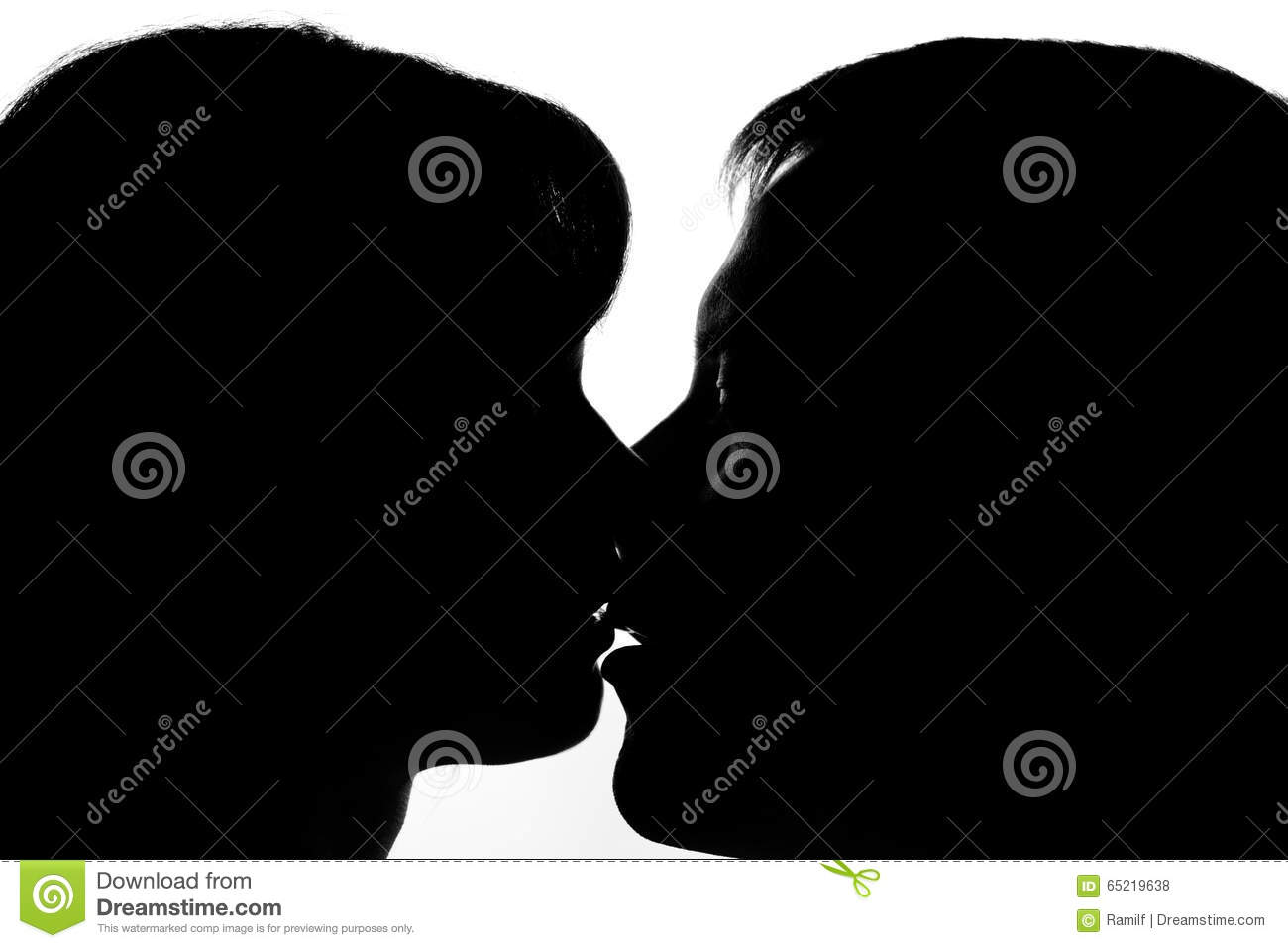 Black and white silhouettes of couples in love during a kiss