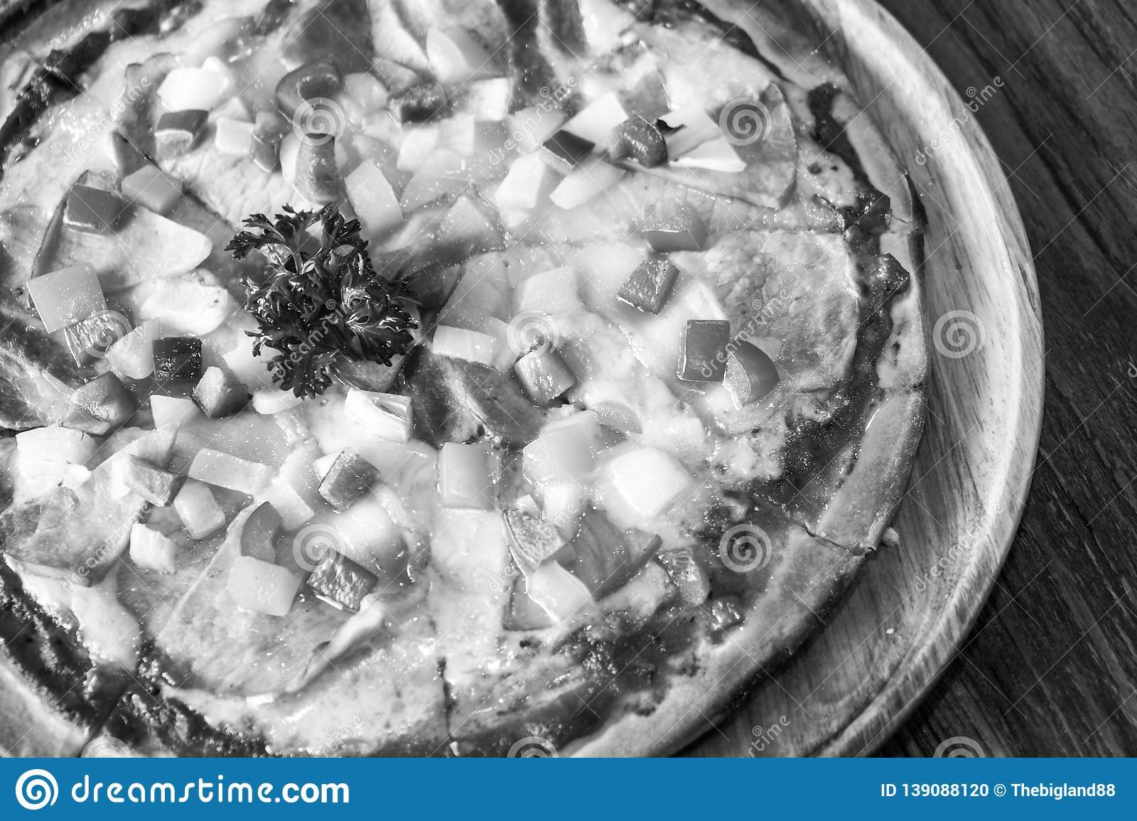 Black and white tone Close up of tasty and crispy homemade seafood topped pizza, fusion food style