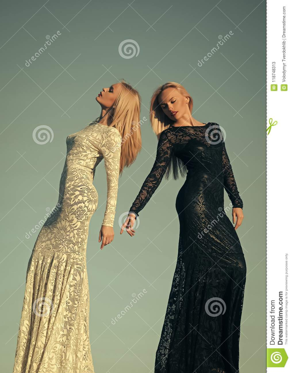 Black and white. Women wearing black and white dresses