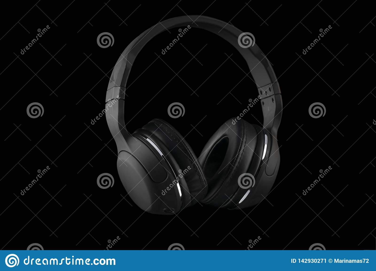 Black wireless headphones isolated on a black background